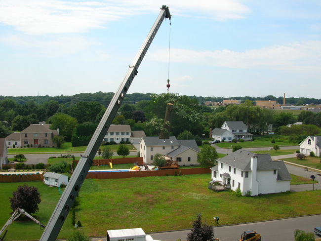 We use different sizes of cranes to minimize lawn damage and maximize efficiency and safety.